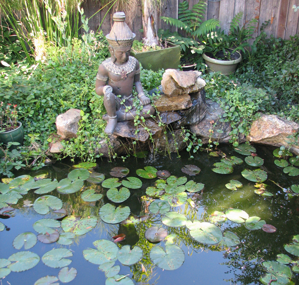 Lily pads and a buddha in a garden.  2011 Martinez Home Tour.