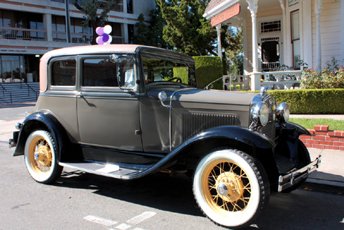 A classic car parked at the Martinez Museum during the Martinez Historic Home Tour