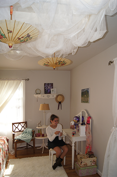 Unique ceiling treatment in a teenage girl's bedroom