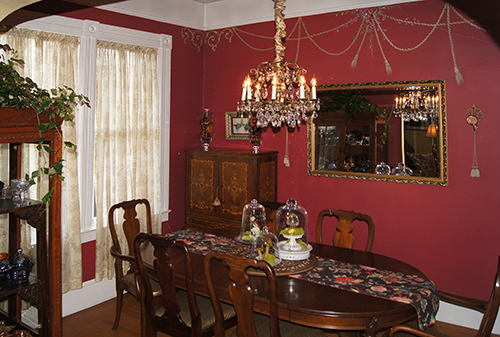 Trompe l'oeil swags on the wall of a Victorian dining room