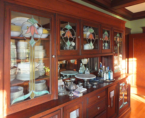 This is a built-in sideboard and china cabinet in a Craftsman home in Martinez, California.